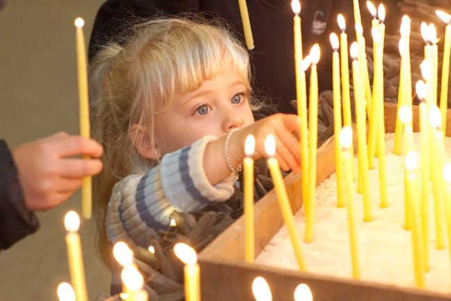 SMCT Events & Tours - Young Girl lighting candles at Christmas Service